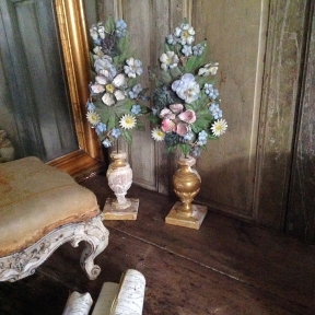 flower branches in wooden altar vases