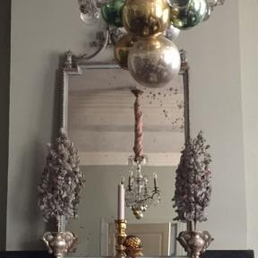 Silvergrey ornaments in wooden altar vases