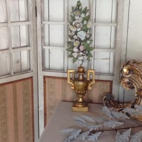 Altar vase with a zinc branch of flowers