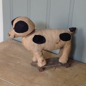 antique doggy on small iron wheels.