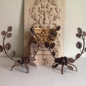 2 wrought iron ornaments with roses